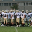 The 49ers team huddling before the game