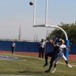 Ariyon Huff battles Hartnell defense in touchdown attempt.