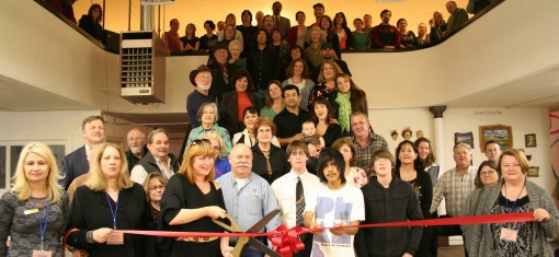 Lily Noonan, surrounded by artists and supporters, cuts the ribbon during Gallery 34's Grand Opening. (Photo provided by: Greg Erwin, Marysville Chamber of Commerce)