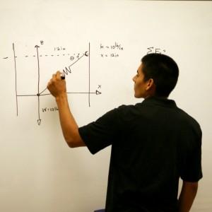 Christian Ruiz is demonstrating an equation | Photo by: Robert Angus