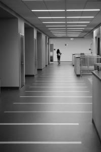 A student strolling through an empty hallway.