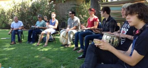 An array of age groups participating in a drum circle at Yuba College | Photo provided by Dr. Mathews