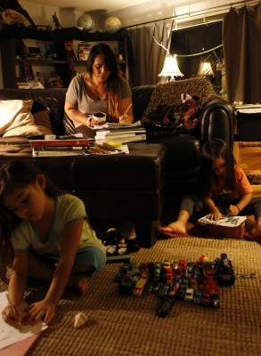 Kimberly Sullivan, studying hard while her children color and play   Photo by Heather Meunier