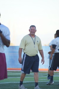 Coach Ted Hoal asseses the 49ers at practice | Photo by Robert Angus
