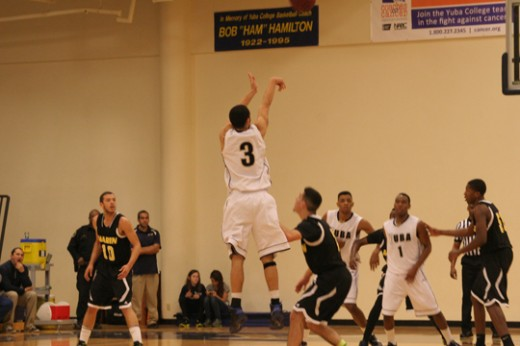 Darrell Polee Jr hoping to make a three | Photo by Bob Barton