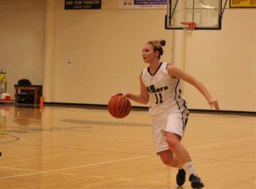 Kylie Nore looking to pass a defender | Photo by Bob Barton