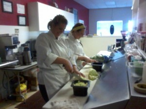 Prepping for the Grand Opening: Stephanie Whisenant (l) Maggie Phillips (r)