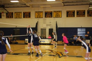 Kylee Sallaberrey and Amgela Dehaan converge at the net in a game against Contra Costa