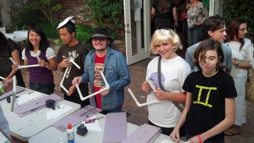 Anime fans take part in a props-workshop to hone their skills at costume-making, stage production, and of course,  prop interaction.