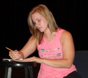 Alyssa Patterson (Dorine) studies her lines during a break