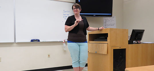 Cari Carter listening to one of her students telling a story.