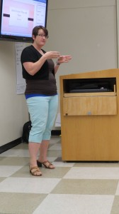 Carter teaches her class about cued speech.