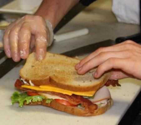 A student finishing a California sandwich.
