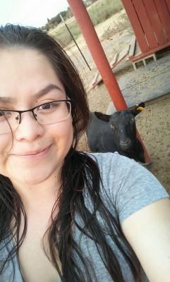 Ana on farm duty with a goat. (Photo courtesy of Ana Martinez.)