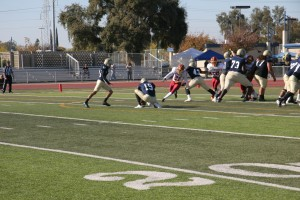 Marco Diaz attempts a field goal against College of the Redwoods