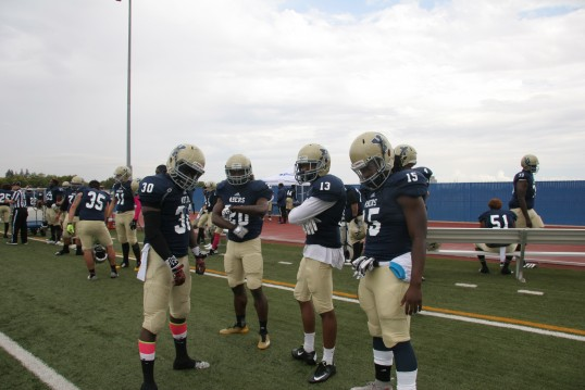 Yuba College players clowning on the sideline. Pictured from left to right are Kevin Brunner, Devontee McNamee, Isaiah Francis, and Chedson Jean