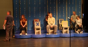 """Gilbreath working with cast of """"The 25th Annual Putnam County Spelling Bee."""""""