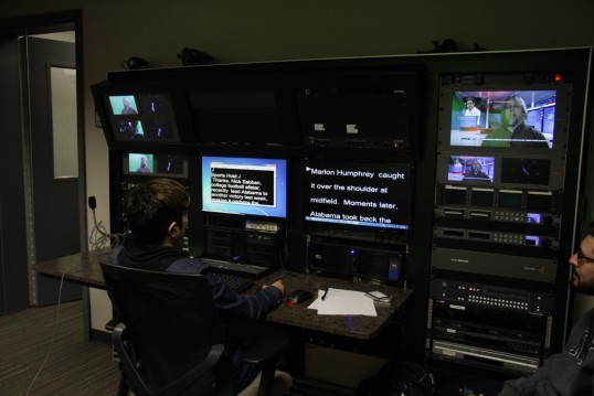 A student works the teleprompter for a Mass Communications 4 class.