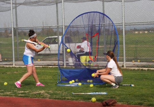 A player practices her swing.