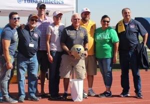 Multiple faculty at halftime alumni presentations.