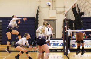 Heather Harness spikes the ball on Alameda's defense.