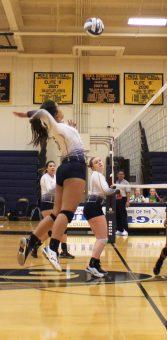 Alejandra Martinez spikes the ball on Alameda defense.