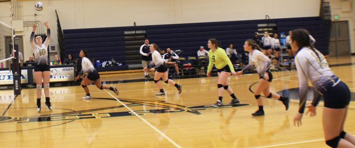 Volleyball team lined up in position for offensive attack on opponent Alameda