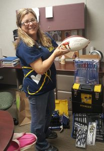 Tammy Pack shows off an autographed football donated for the auction.