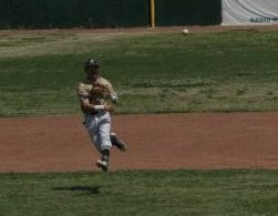 Shortstop Weston Gaddis makes a throw down to first base for an out.