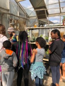 R Spot kids Checking out the plants in the greenhouse with Presley